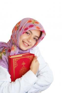 Little muslim girl hold her Koran