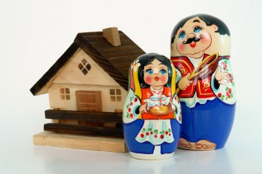 Russian nested dolls and house