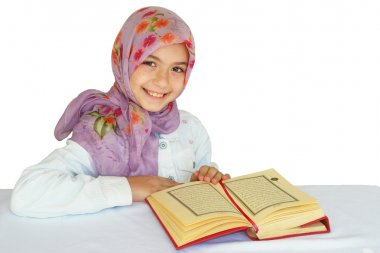 Little muslim girl read her Koran
