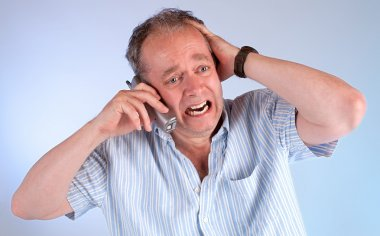 A middle aged man is upset upon receiving very bad news on the telephone. stock vector