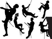 Fotografia sagome di scalatori di roccia