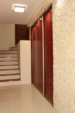 Hall with stairs in modern apartment