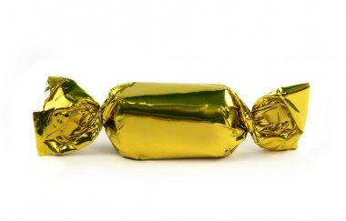 Single gold candy isolated