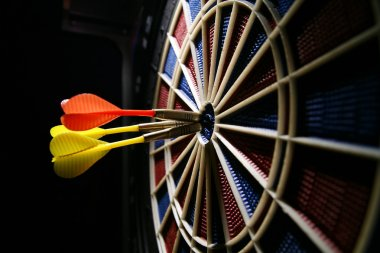 Dart board with three darts