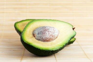 Two halves of avocado stock vector