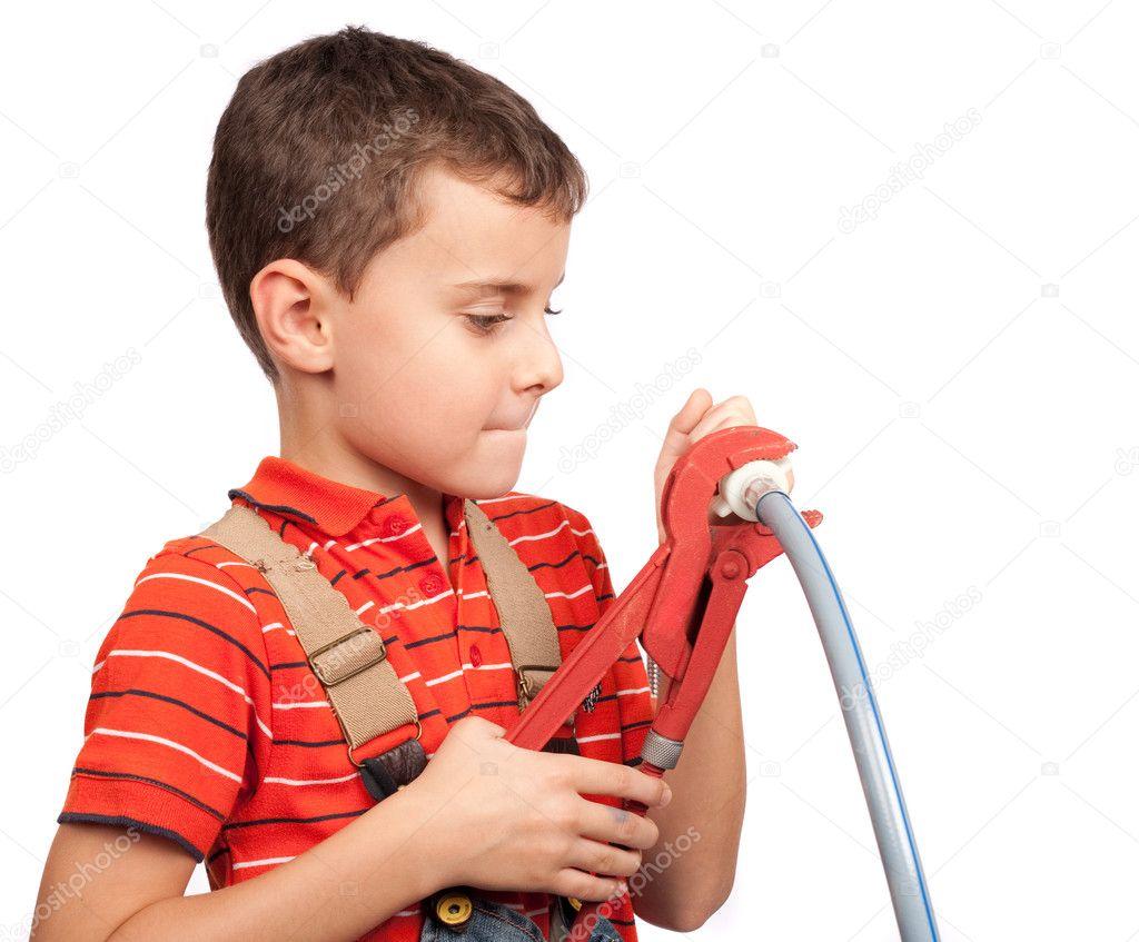 Cute kid posing as a plumber