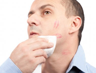 Man wiping lips traces from his face