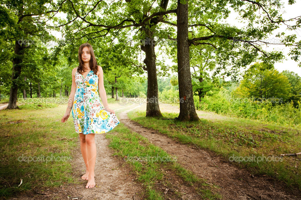 Barefoot woman walking in the forest