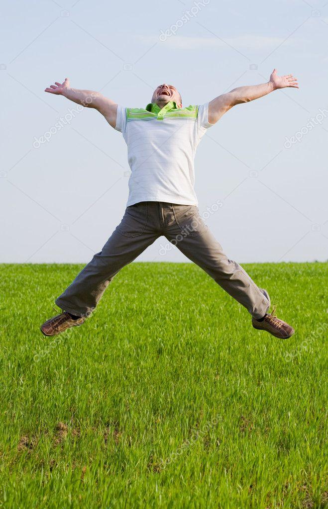 Happy man in a wheat field