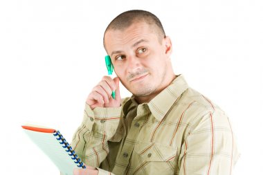 Young casual businessman writing