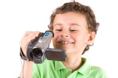 Boy using video camera