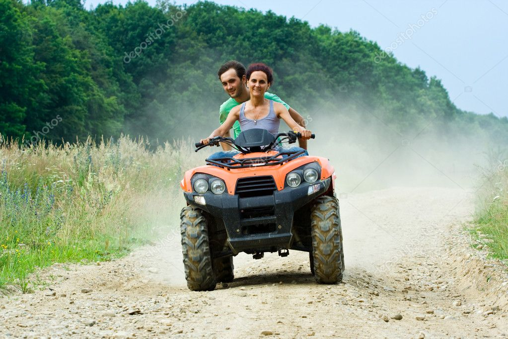 Couple riding ATV