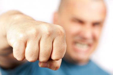 Aggressive man punching