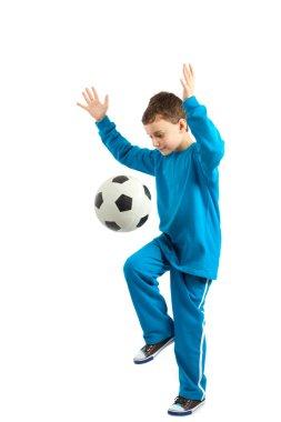 Boy executing a football kick