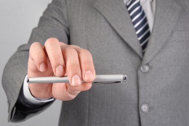 Businessman giving you the pen