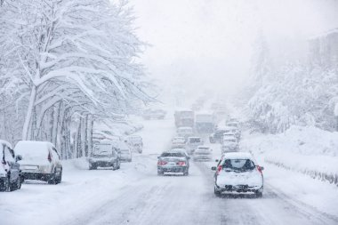 Snowstorm, poor visibility,slick roads and lots of traffic stock vector