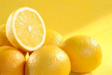 Group of lemon on yellow background
