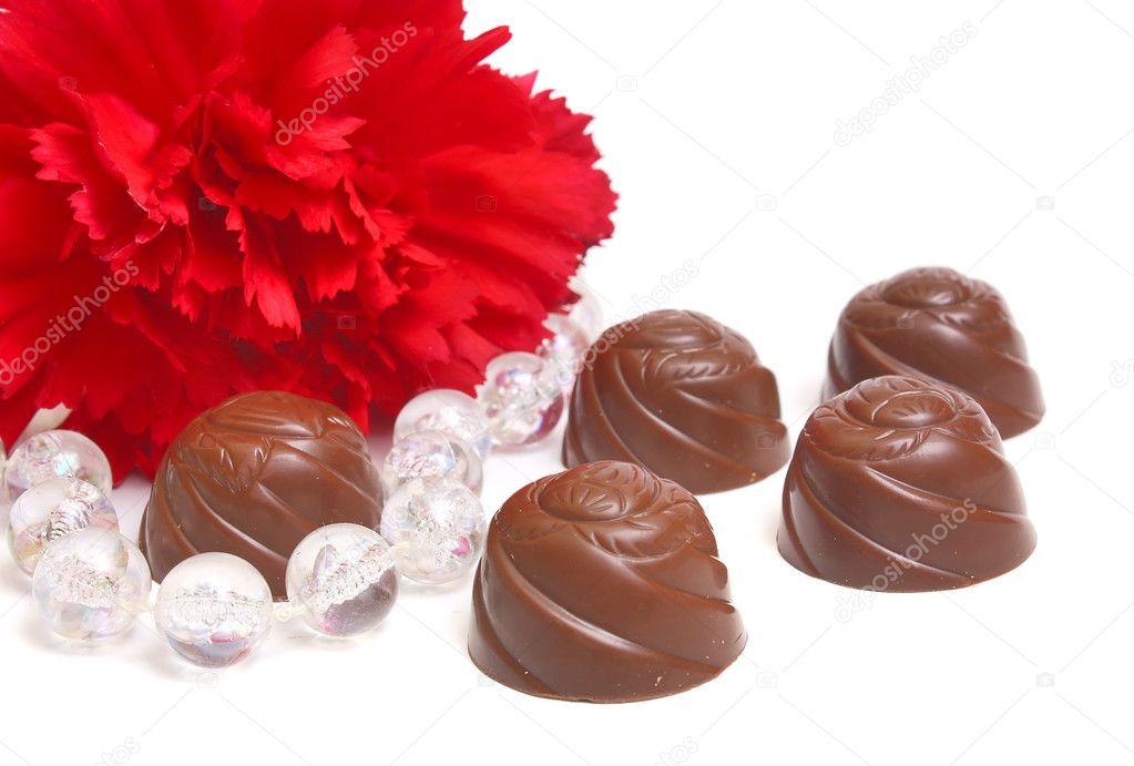 Chocolat Et Fleur Photographie Kontur Vid C 2032176