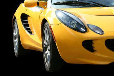 Isolated yellow sports car on black
