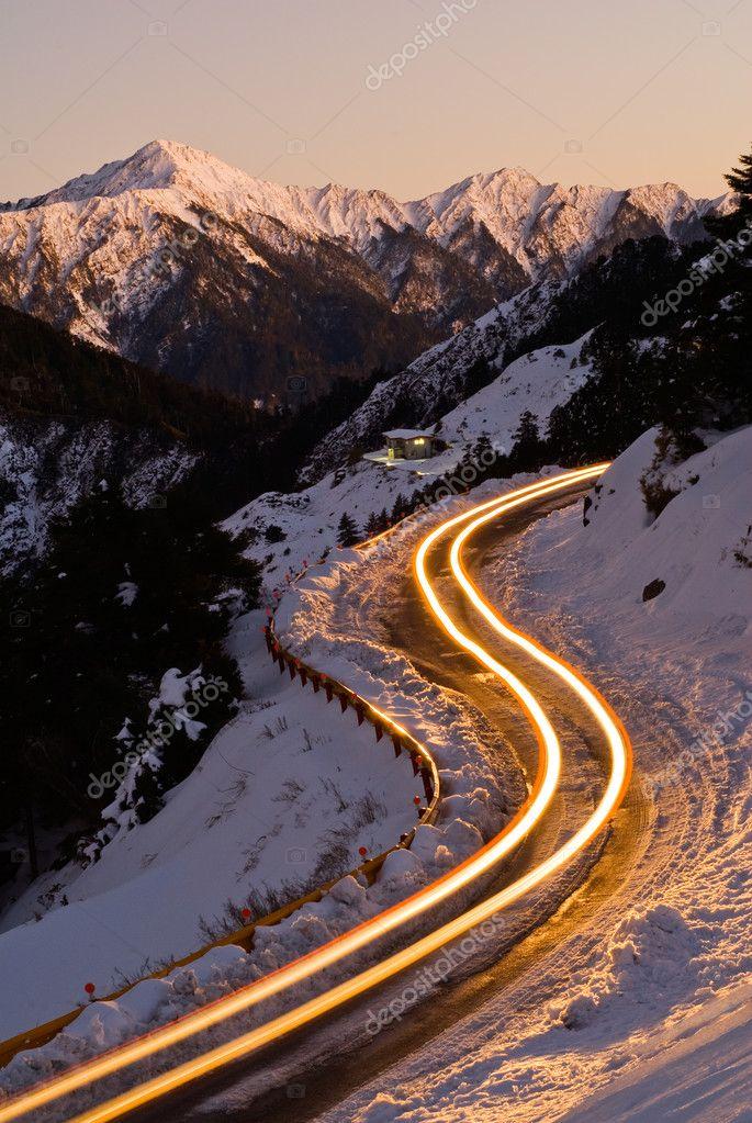 Car light in night on ice road