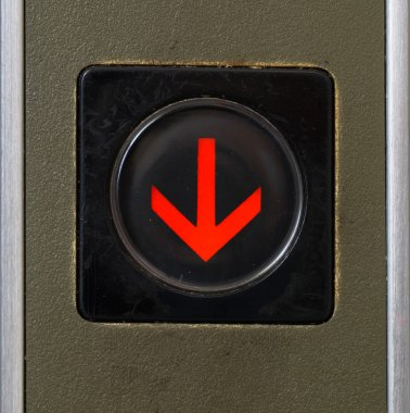 Close-up elevator button of down sign