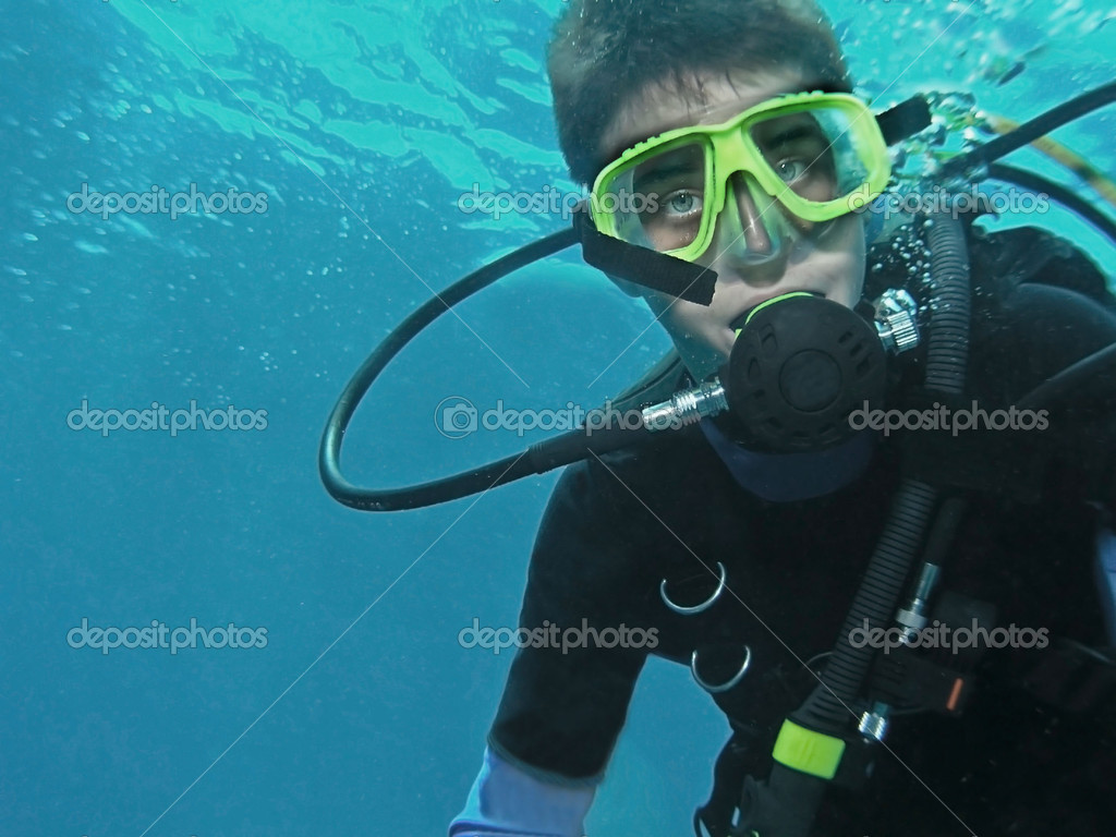 Young scuba diver underwater
