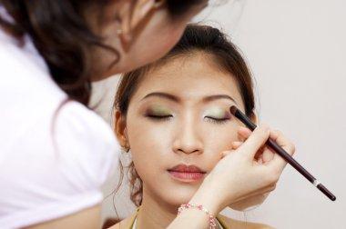 Applying makeup.