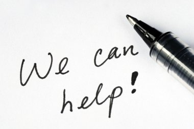 The words We Can Help on a white paper