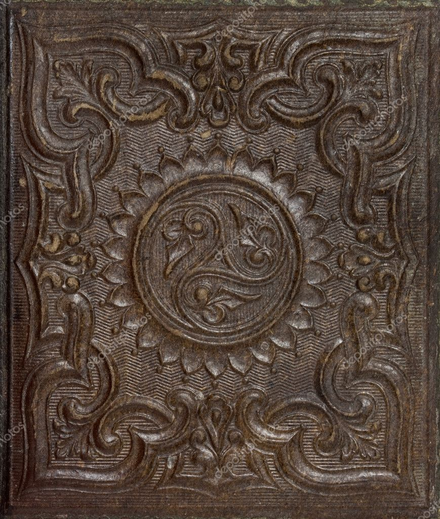 Antique brown stamped gutta-percha background (natural latex) with floral patterns and some scratches - a cover of nineteenth century daguerreotype portrait