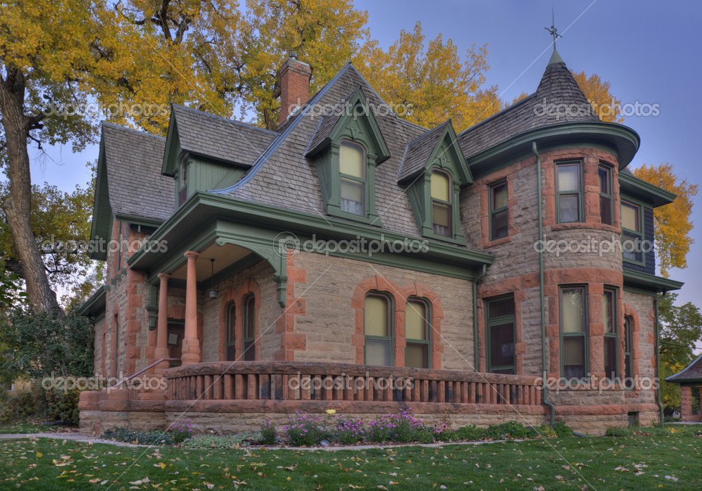 Avery house - historical landmark of Fort Collins, Colorado, at dawn against fall cottonwood foliage