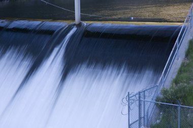 River dam spillway and fence