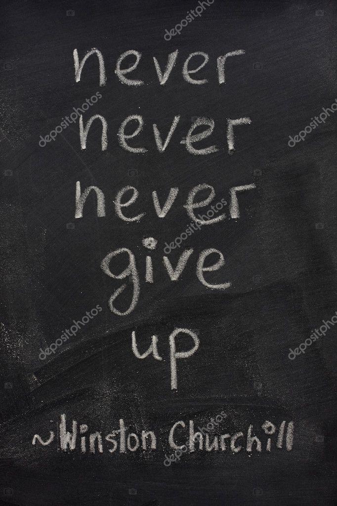 Never Give Up Phrase On Blackboard Stock Photo