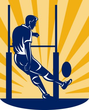 Rugby player kicking at goal post