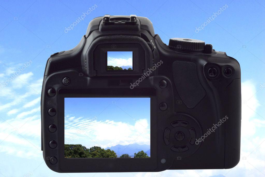 Photocamera shooting sky