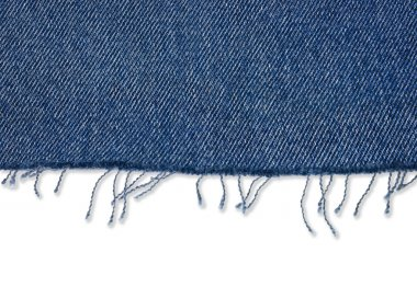 Piece of jeans fabric with fringe