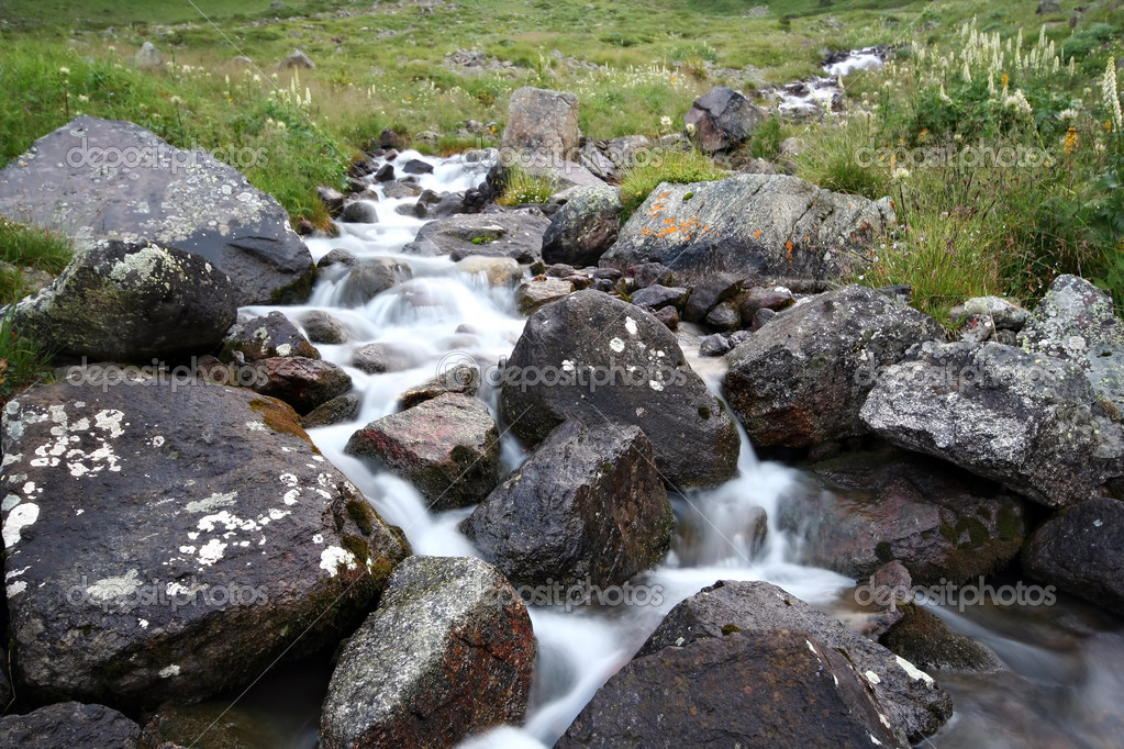 Stream of mountain river among stones
