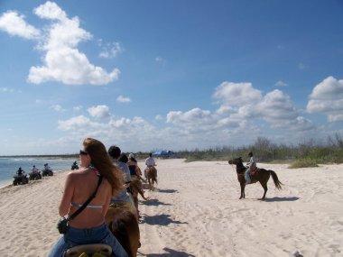 Horseback riding on the beach.