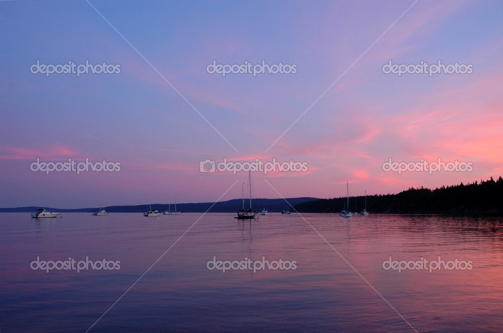 Boats at sunset in shore of Lopez Island