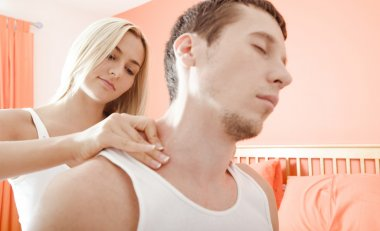 Woman Massaging Man's Shoulders