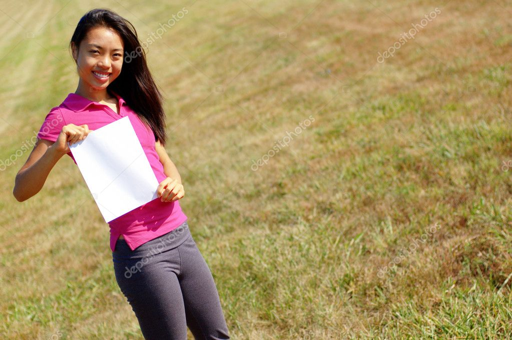 Girl holding a sign
