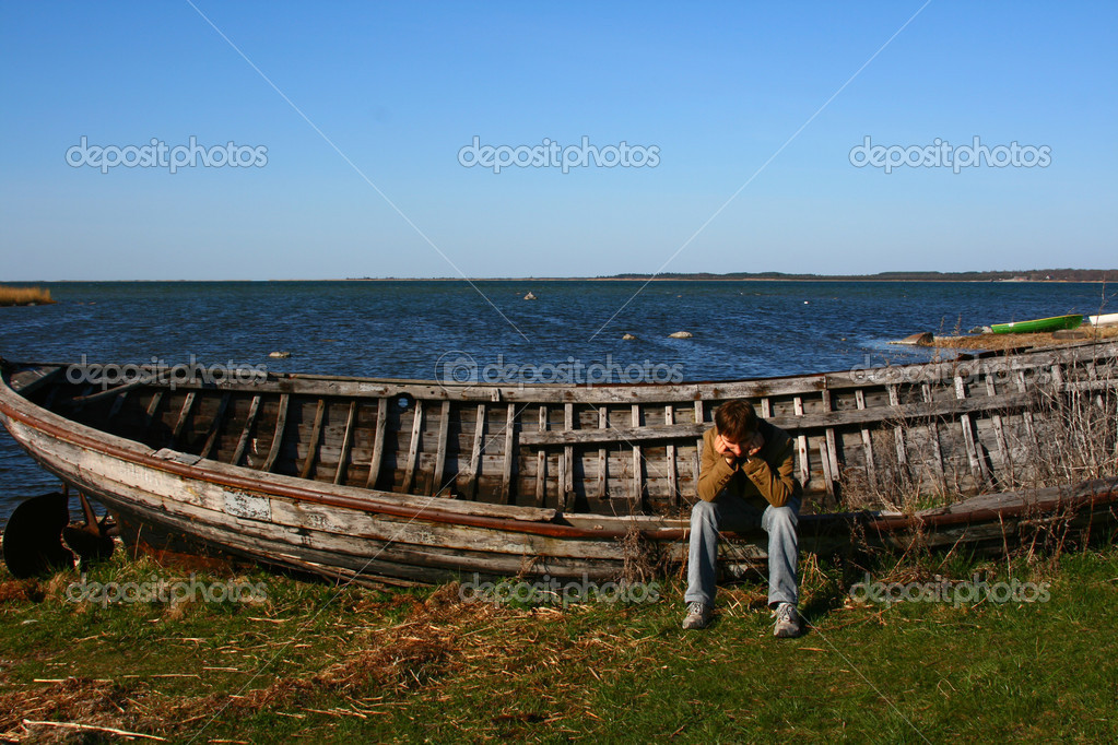 Sad Man Near The Old Wooden Boat Stock Photo Almotional 2319213
