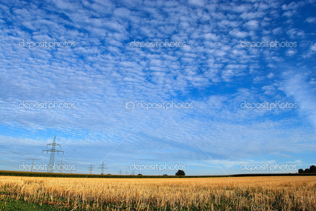 Clouds over rural landscape
