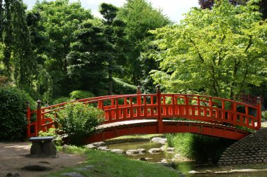 Red bridge in a japanese garden