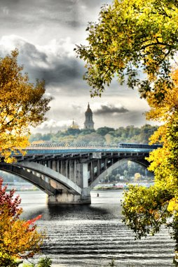 Beautiful autumn landscape of Kiev subway bridge