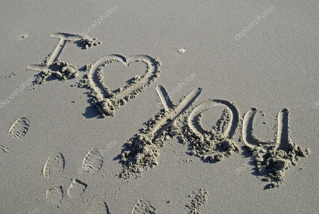 I love you inscription in sand