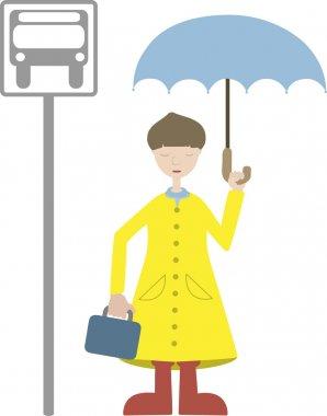 Child going to school wears rain gear