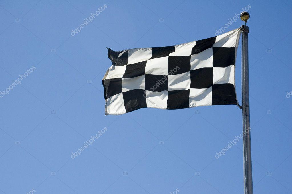 checkered finish line flag on pole stock photo suwanneeredhead