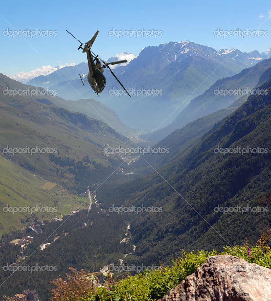 The helicopter flies in mountains