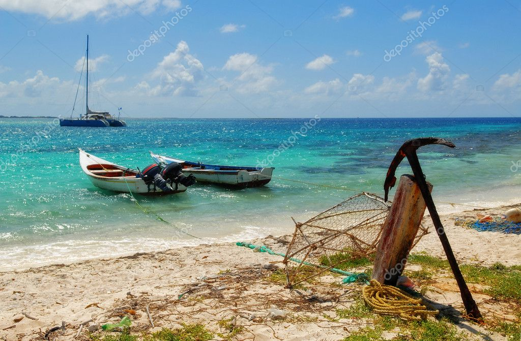 Two fishing boats and old anchor