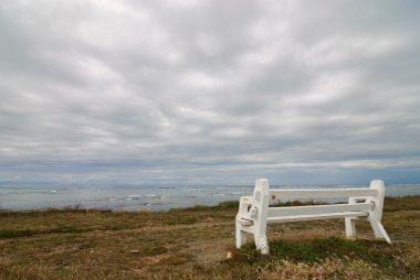 Empty bench and stormy weather